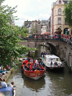 A boat concert parade in one of the canals running through the city