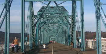 Crossing the Tennessee River on the Walnut Street Bridge is only possible by foot or by bike. Built in 1890, it is one of the world's longest pedestrian bridges.