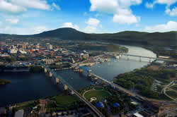 Aerial view of the Tennessee River, North Shore and Downtown Chattanooga, and Lookout Mountain in the background.