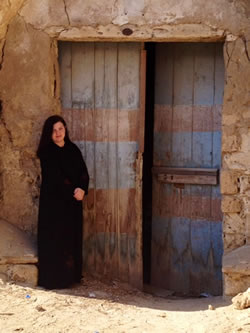 This is me (in my abaya) deep in the historical ruins in Yanbu, Saudi Arabia.