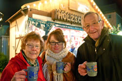 Enjoying the Christmas market with my grandparents
