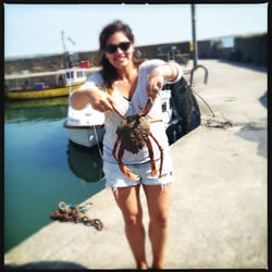 Holding a spider crab which I was going to cook for lunch.