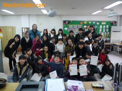 Brian and Noelle with students in Korea.