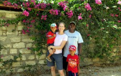 the Kenyan-Texan family in front of bougainvillea