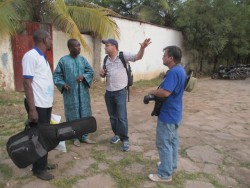 Jamey at a photo shoot with Malian musician Baba Salah.