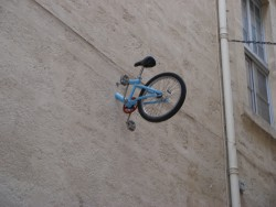 One of Montpellier's biggest mysteries. Who are the tiny bicyclists and why do they keep getting their bicycles stuck in second-storey apartments?