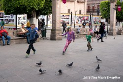 Kids playing with the pigeons in downtown Morelia.