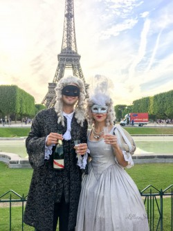 Enjoying drink before the annual Masked Ball at Versailles
