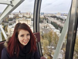 A photo of me on one of two Ferris wheels in the city.