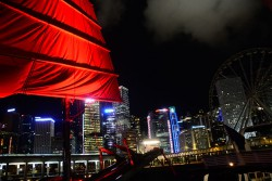 Hong Kong's skyline is one of the most beautiful in the world. The Aqualuna, red-sailed junk boat is a great way to see it.