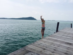 My daughter jumping off the pier at Telunas Beach Resort.